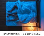 the couple laying under a duvet ... | Shutterstock . vector #1110434162