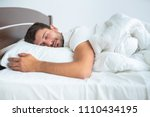 the man sleeping on the bed on... | Shutterstock . vector #1110434195