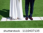 couple is standing on an... | Shutterstock . vector #1110437135