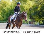 teenage girl riding bay horse... | Shutterstock . vector #1110441605