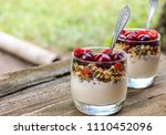 granola with yogurt and berries ... | Shutterstock . vector #1110452096