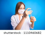 girl in a medical suit holds a ... | Shutterstock . vector #1110460682