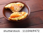 homemade pizza on a clay plate  ... | Shutterstock . vector #1110469472