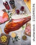Small photo of JAMON SERRANO. Whole leg of ham serrano and spanish or italian meat snacks, red an rose wine. Top vie, flat lay.