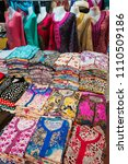 Small photo of Agadir, Morocco - march 01, 2016: Colorful Arabic costumes for women exposed on the outside of a souk trade El Had in the urban center of the city
