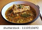 salmon soup  fried onion ... | Shutterstock . vector #1110510692