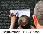 Small photo of WASHINGTON,D.C. USA - Jun 06,2018; Student tried to look for the name on the wall as the teacher proposition at Vietnam Veterans Memorial.