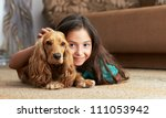 Stock photo the girl is lying in the floor with the dog 111053942