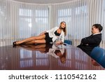 woman on office desk seduce boss | Shutterstock . vector #1110542162