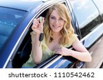an attractive woman in a car... | Shutterstock . vector #1110542462