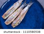 Stock photo a herring fillet on a blue plate a traditional dutch delicacy tasty food copy space flat lay 1110580538