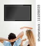 young couple watching tv. photo ... | Shutterstock . vector #111058535