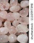 tumbled rose quartz gem stone... | Shutterstock . vector #1110597398
