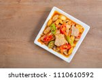 stir fried pork with roasted... | Shutterstock . vector #1110610592
