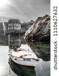 a small motorboat tied to the...   Shutterstock . vector #1110627632