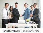 businesspeople making handshake ... | Shutterstock . vector #1110648722