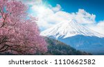 mountain fuji and pink cherry... | Shutterstock . vector #1110662582