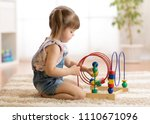 kid girl playing with... | Shutterstock . vector #1110671096
