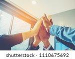 business teamwork joining hands ... | Shutterstock . vector #1110675692