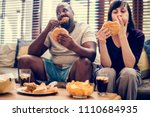 couple having fast food on the... | Shutterstock . vector #1110684935