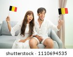 belgium soccer fan cheering and ... | Shutterstock . vector #1110694535