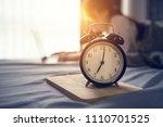 closeup alarm clock  business... | Shutterstock . vector #1110701525