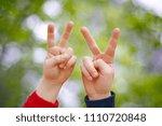 two children's hand displaying ... | Shutterstock . vector #1110720848