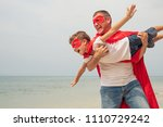father and son playing... | Shutterstock . vector #1110729242