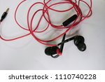 obsolete entangled earphones  | Shutterstock . vector #1110740228