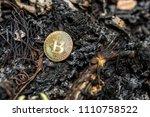 gold bitcoin on burnt trash or... | Shutterstock . vector #1110758522