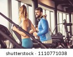 sportspeople having exercise on ... | Shutterstock . vector #1110771038
