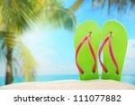 Flip Flops On Sand Beach.