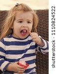 Small photo of Boy with icecream in outdoor cafe. Child eat ice cream in cup with spoon. Food, refreshing dessert eating concept. Kid with frozen fruit yogurt, gelato or sorbet.