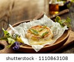 grilled camembert cheese with... | Shutterstock . vector #1110863108