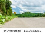 country road with warning... | Shutterstock . vector #1110883382