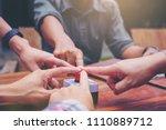 multiple hands join for push... | Shutterstock . vector #1110889712