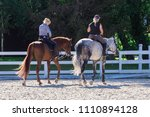 two girls in helmet riding... | Shutterstock . vector #1110894128