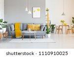 orange blanket on grey sofa in... | Shutterstock . vector #1110910025