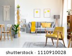 yellow armchair on rug near... | Shutterstock . vector #1110910028
