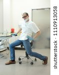 male dentist stretching his... | Shutterstock . vector #1110913058