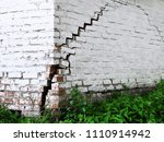 brick house with a crack for... | Shutterstock . vector #1110914942