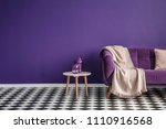 dark purple sofa with a blanket ... | Shutterstock . vector #1110916568