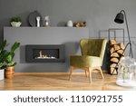 black fireplace between plants... | Shutterstock . vector #1110921755