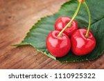 cherry   heap of berries on... | Shutterstock . vector #1110925322