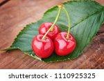 cherry   heap of berries on... | Shutterstock . vector #1110925325