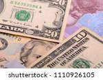 dollars and hryvnia banknotes... | Shutterstock . vector #1110926105