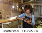 young woman using a tablet in... | Shutterstock . vector #1110927842