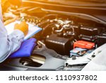 engineers are checking cars.... | Shutterstock . vector #1110937802