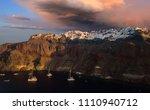 the famous sunset at santorini... | Shutterstock . vector #1110940712