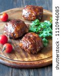 meatballs wrapped in bacon on... | Shutterstock . vector #1110946085
